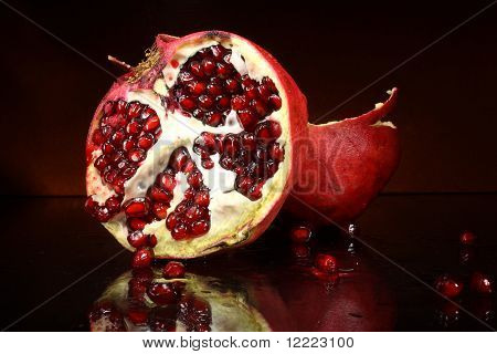 photo red fruit grenades on a dark background