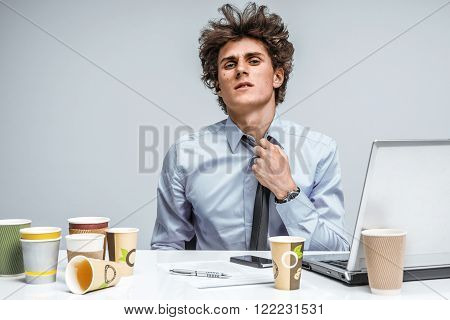 Tired student. Overwhelmed man turned away from the laptop screen. Education concept