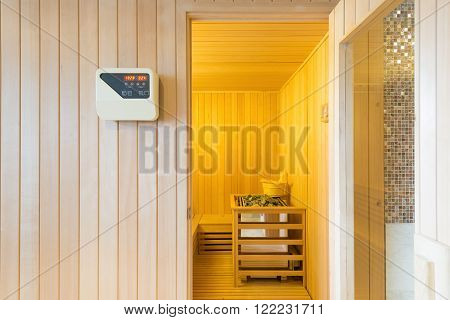 Large standard-design classic wooden sauna interior in public building