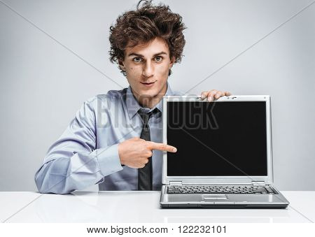 Young businessman specify at screen laptop / modern businessman at the workplace working with computer. Business concept
