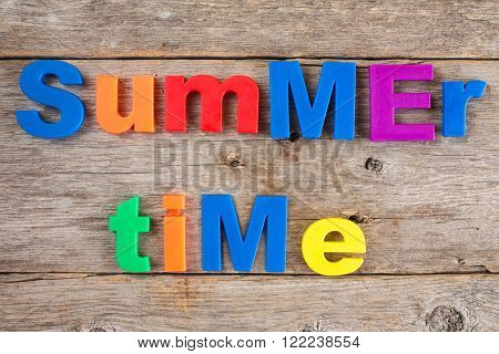 Colored Letter magnets spelling text Summer time