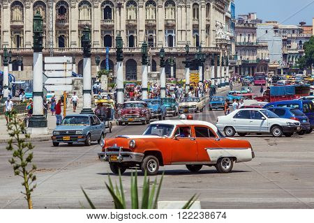 Havana, Cuba - April 1, 2012: Heavy Traffic With Taxi Bikes And Vintage Cars