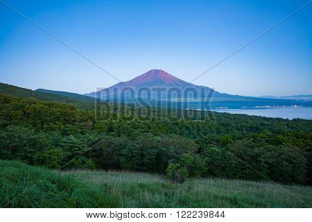 Red color at Top of Mountain Fuji in summer early morning seen from Lake Yamanaka Yamanashi prefecture