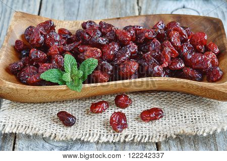 Dried cranberries on the wood backgraund.  Healthy food organic nutrition.