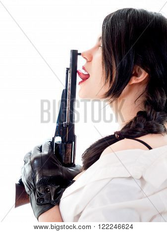 sexy girl touching with her tonge an old revolver