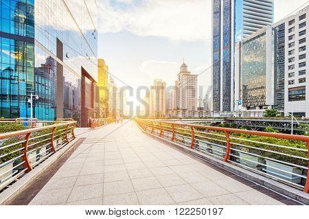 empty footpath between modern buildings at sunrise in guangzhou