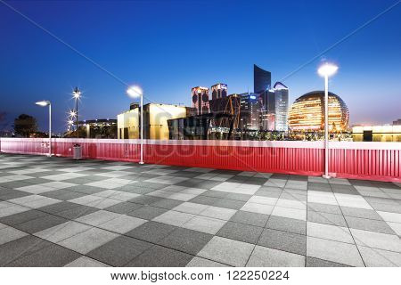 empty marble floor with cityscape and skyline of hangzhou