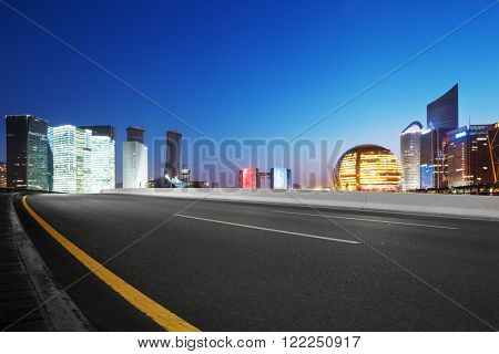 empty asphalt road with cityscape and skyline of hangzhou