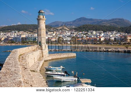 Venetian lighthouse and wall at old harbour in Rethymno (Rethymnon), island of Crete, Greece, Mediterranean
