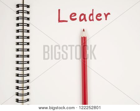 Red pencil and handwriting word