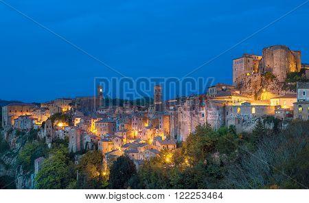 Sorano - tuff city in Tuscany. Italy. View in the dusk with illumination, travel background