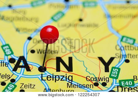 Photo of pinned Leipzig on a map of Germany. May be used as illustration for traveling theme.