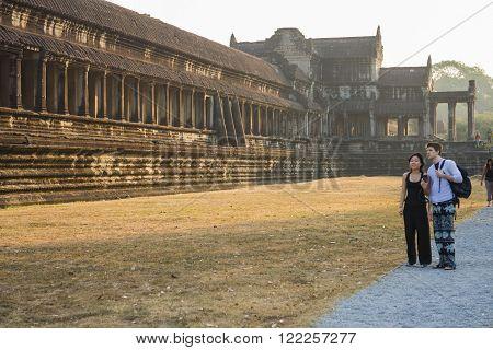 Angkor Wat, Siem Reap, Cambodia - Februaty 10, 2015 :: Tourists walking in Angkor Wat, Siem Reap Cambodia