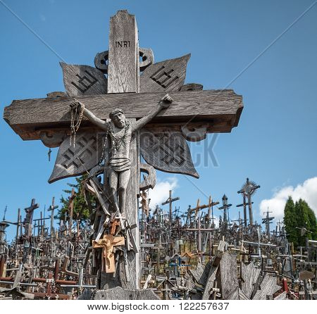 SIAULIAI, LITHUANIA - JUL 12, 2015: Hill of Crosses is a unique monument of history and religious folk art in Siauliai Lithuania. Text on the crosses in different languages - O God protect our family give health.