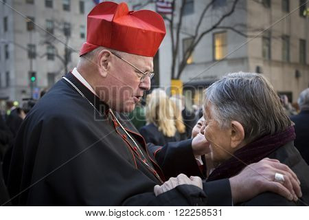 NEW YORK-MAR 17, 2016: Timothy Cardinal Dolan Archbishop of New York greets Gabe Pressman, senior correspondent for WNBC in front of St Patricks Cathedral on Saint Patricks Day, Manhattan Mar 17 2016.