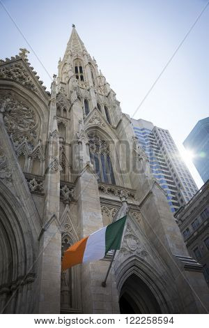 NEW YORK - MARCH 17, 2016: The Irish tricolour green, white, and orange flag of Ireland waves from St Patricks Cathedral on Saint Patricks Day in Manhattan on March 17, 2016.