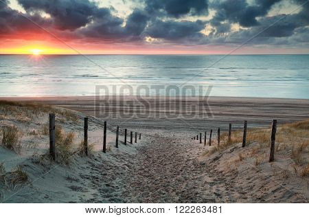 sand path to North sea beach at sunset North Holland Netherlands