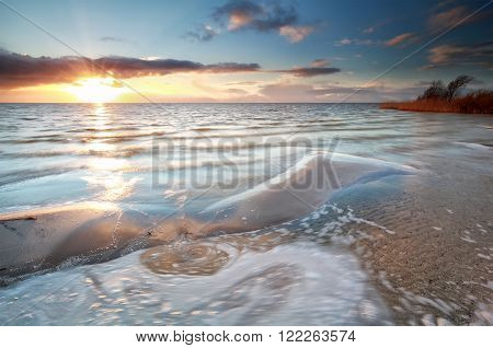 gold warm sundown on sand coast Ijsselmeer Netherlands