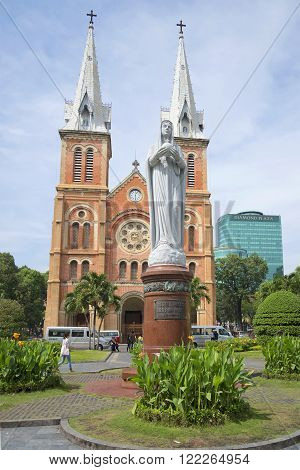 HO CHI MINH CITY, VIETNAM - DECEMBER 19, 2015: The monument virgin Mary in the background of the Cathedral. The main attraction of Ho Chi Minh city