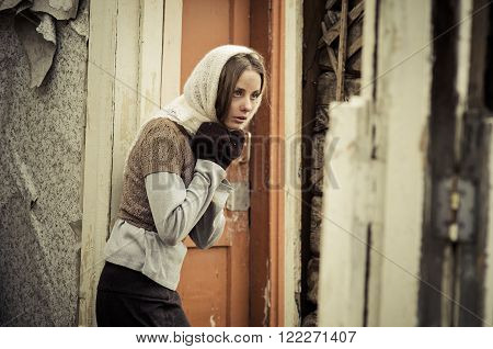 Young Girl Dressed In The Poor Sweater And Scarf