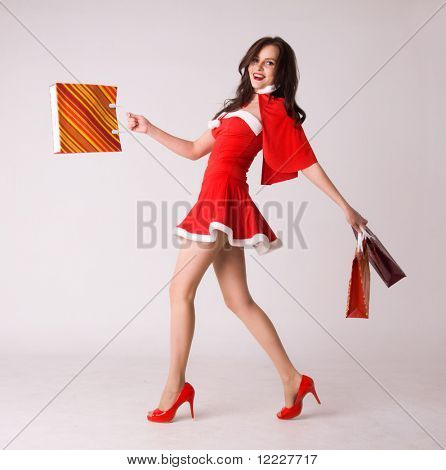 sexy smiling woman shopping in red xmas costume
