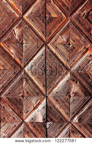 Wooden checkered, diamond background of ancient door
