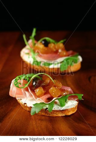 toasts with home-made apple chutney,ham,ricotta cheese and arugula