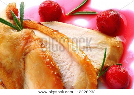 Sliced turkey breast with cranberry sauce and  rosemary