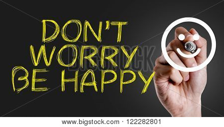 Hand writing the text: Don't Worry Be Happy