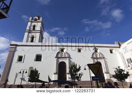 Camaguay Cuba - December 27 2015: Street view of church in Holguin Cuba.