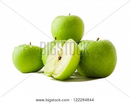 Group of granny smith apples covered with drops of water isolated over white.