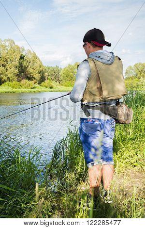 Fishing, fishing on the river. Spinning fishing