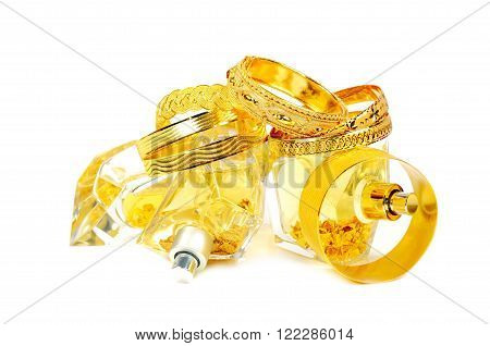 Golden bracelets and perfumes with golden flakes inside