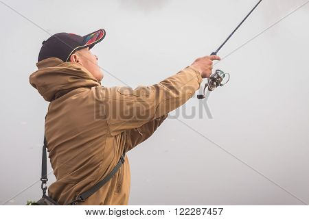 Autumn fishing. Fisherman in his hand holding spinning. Fishing, spinning reel, fish, Breg rivers. - The concept of a rural getaway. Article about fishing. ** Note: Soft Focus at 100%, best at smaller sizes