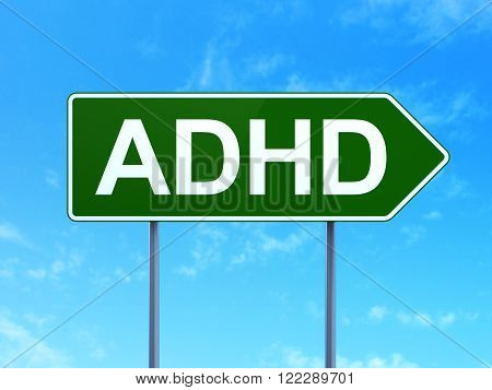 Medicine concept: ADHD on road sign background