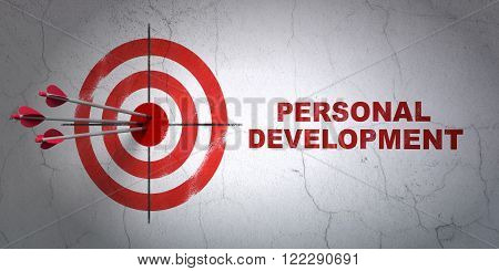 Learning concept: target and Personal Development on wall background