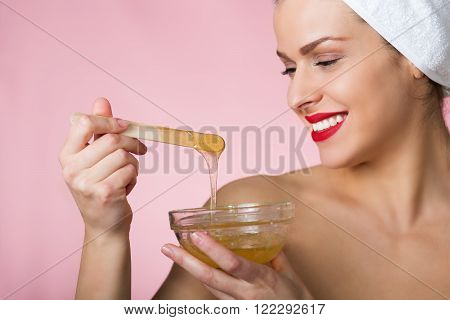 Beautiful woman with sugar hair removing paste