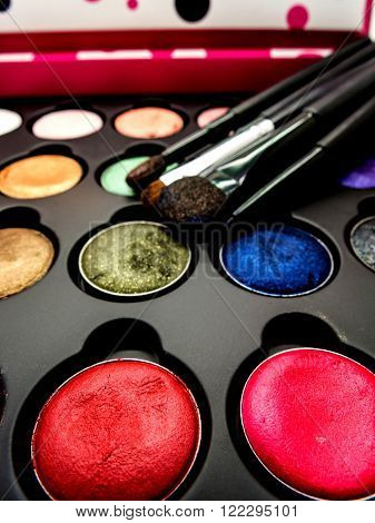 used multi-color cosmetic cushion eye shadow eye liner brusher lip highlight shading selective focus