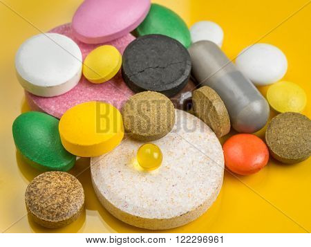 All sorts of drugs over yellow background
