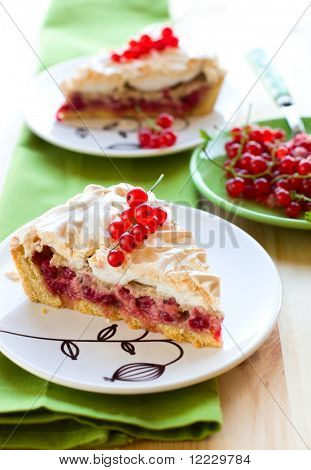 Piece of red currant meringue tart