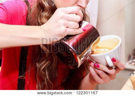 Female barista in the workplace. Girl makes coffee using coffee machine. Coffee, cappuccino, coffee, coffee shop, the bartender - the concept of catering. Use in articles about coffee.