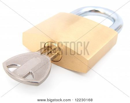 Golden Closed Padlock With Key