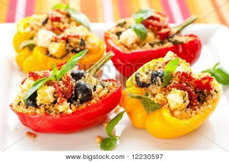 stuffed peppers with couscous, dried tomatoes,feta,olives and basil