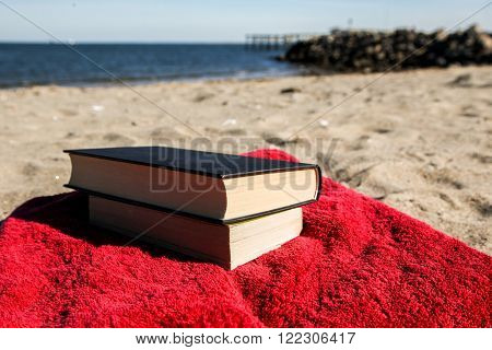 Book on beach with blue sky horizontal