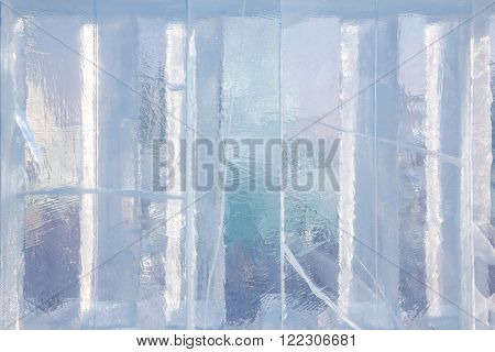 Ice block background with cracks outside on a sunny day