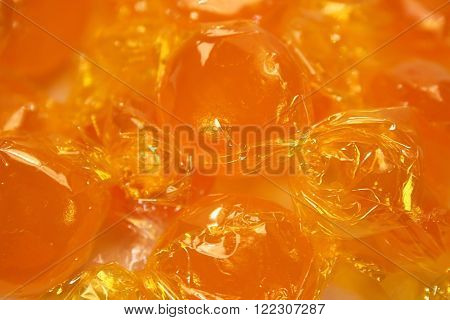 Butterscotch Candy. Extra close-up photo of individually wrapped butterscotch hard candy.