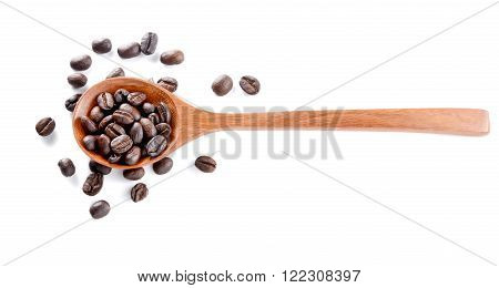 Roasted coffee in woden spoon placed on white background.