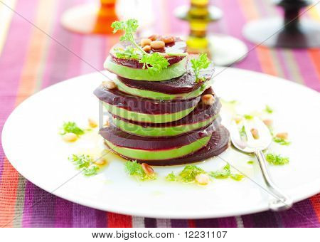 Tower of beetroot and avocado with pine nut