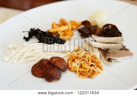 Asian mushrooms on plate, small focus depth