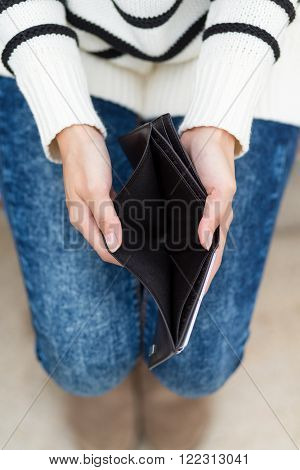 Woman with an empty wallet